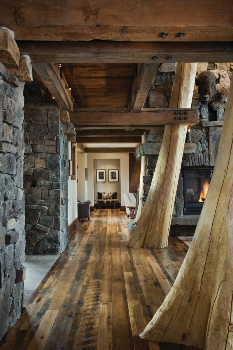 alluring-long-hallway-with-wooden-floor-and-decorative-stone-wall-design-also-lovely-bench-and-wall-frames-decoration-at-the-end-of-the-hallway