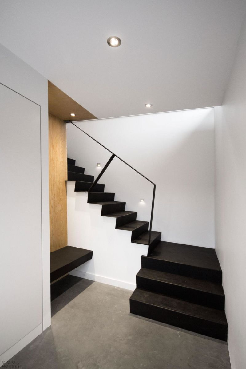 fascinating-staircase-design-with-black-steps-and-iron-handrail-also-simply-bench-on-a-wooden-panel-with-recessed-ceiling-lamps-decor