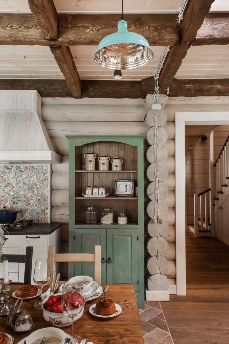an-interesting-kitchen-hallway-with-wooden-flooring-and-unique-green-cabinet-and-tosca-pendant-lamp