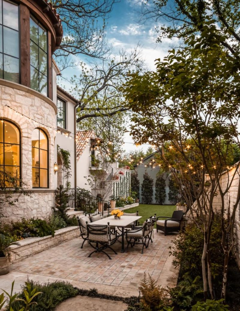 cocy-retro-the-design-of-the-yard-of-a-private-house-with-white-table-plus-iron-chair-plus-brick-floor-as-well-glass-wall-decor-idea