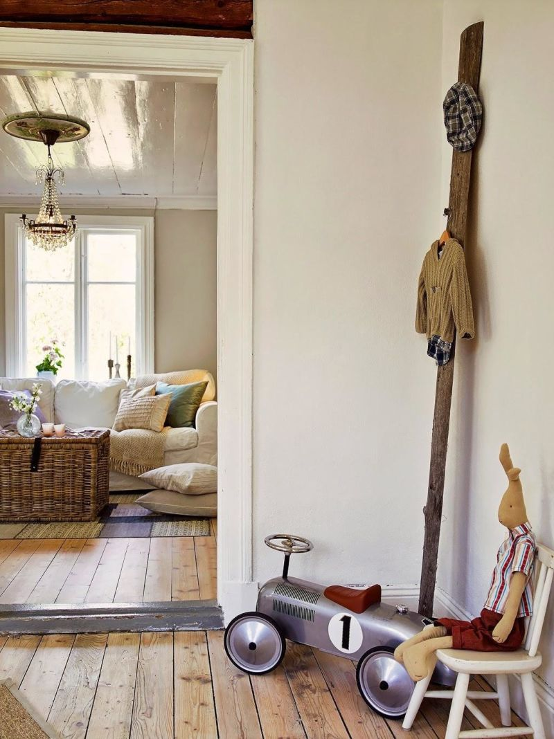 unique-hallway-decoration-with-small-wooden-chair-and-cute-wall-decor