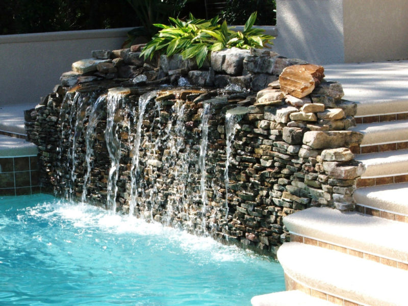 luxurious-exterior-house-idea-with-incredible-swimming-pool-decoration-again-ladder-made-of-concrete-material-also-water-fountain-design-plus-natural-stone-wall