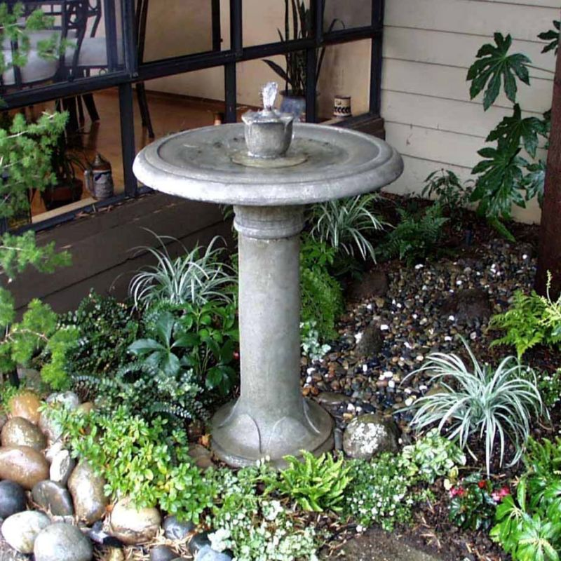 simple-landscaping-ideas-with-decorative-concrete-water-fountain-design-for-small-backyard