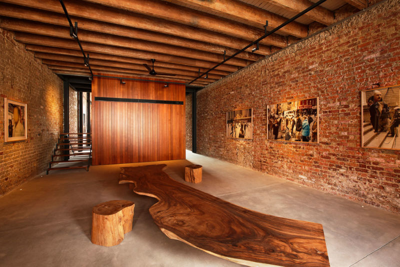 rustic-wooden-seat-also-ceiling-design-combined-with-exposed-brick-wall-and-art-paintings-decor