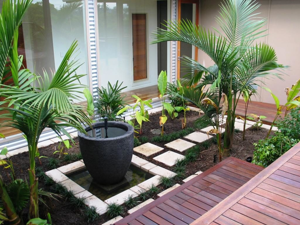 simple-garden-design-with-wooden-pattern-floor-and-green-foliages-idea