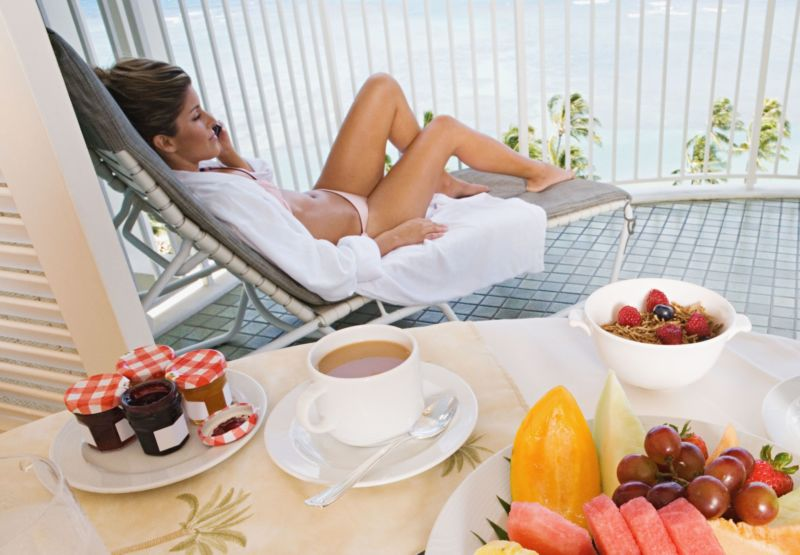 Woman on balcony with breakfast